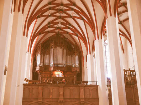 worked: LEIPZIG, GERMANY - JUNE 12, 2014: Organist playing in the Thomaskirche St Thomas Church where Johann Sebastian Bach worked as a Kapellmeister and the current location of his remains vintage