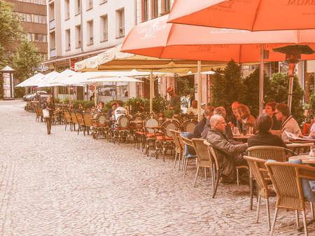 biergarten: LEIPZIG, GERMANY - JUNE 14, 2014: Tourists in a Biergarten the city centre in summer vintage Editorial
