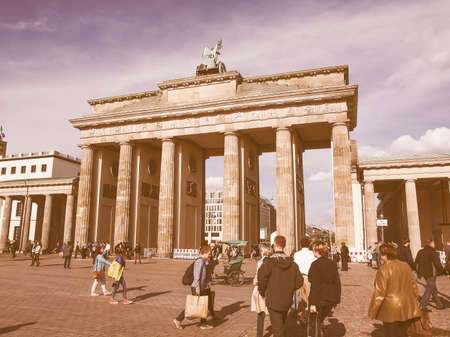 brandenburg gate: BERLIN, GERMANY - MAY 09, 2014: Tourists visiting the Brandenburger Tor (Brandenburg Gate) linking East and West Berlin vintage