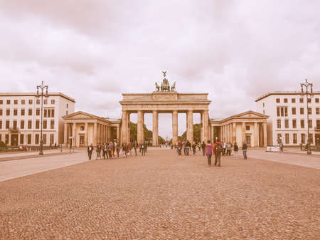 brandenburg gate: BERLIN, GERMANY - MAY 11, 2014: Tourists visiting the Brandenburger Tor (Brandenburg Gate) linking East and West Berlin vintage