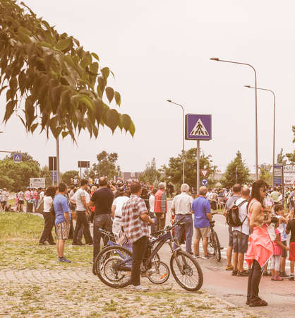 italia: SETTIMO TORINESE, ITALY - MAY 31, 2015: People waiting for riders at the last stage of Giro di Italia meaning Tour of Italy stage bycicle race vintage Editorial