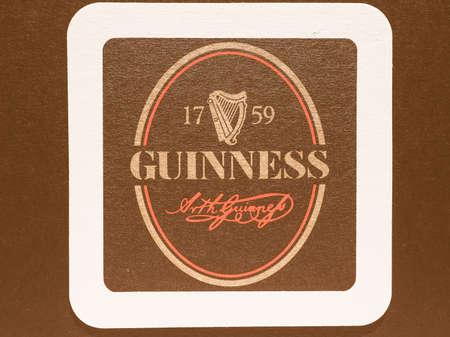 guinness beer: DUBLIN, IRELAND - DECEMBER 11, 2014: Beermat of Irish beer Guinness vintage Editorial