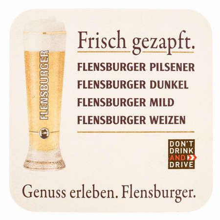 pilsner: FLENSBURG, GERMANY - MARCH 15, 2015: Beermat of German beer Flensburger Pilsner isolated over white background vintage