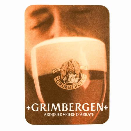 belgie: BRUSSELS, BELGIUM - MARCH 15, 2015: Beermat of Belgian beer Grimbergen isolated over white background vintage