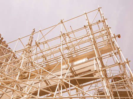 works: Temporary scaffold for construction works at building site vintage