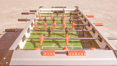 kicker: Table football aka table soccer, foosball from the German Tischfussball, baby-foot or kicker table-top game and sport vintage Stock Photo