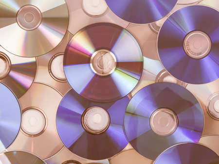 bluray: CD, DVD, BD (Bluray) optical discs for music, video and data storage vintage Editorial