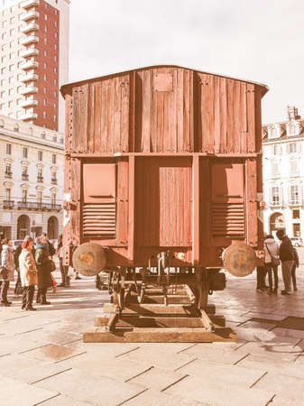extermination: TURIN, ITALY - JANUARY 23, 2015: People visiting an holocaust train for deportation of Jews to concentration forced labour and extermination camps to mark the Primo Levi exhibition in Piazza Castello vintage Editorial