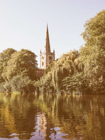 stratford upon avon: Holy Trinity church seen from River Avon in Stratford upon Avon, UK vintage Stock Photo
