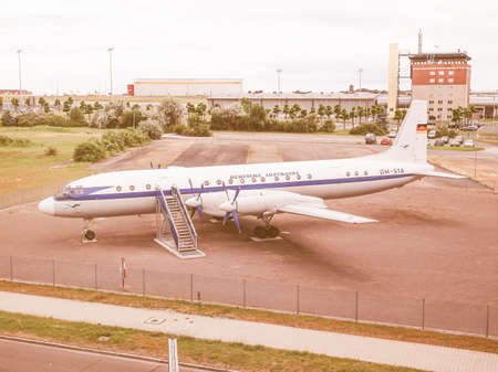 turboprop: LEIPZIG, GERMANY - JUNE 14, 2014: Ilyushin IL-18 aka Coot large turboprop Soviet airliner aircraft from 1957 in display in front of Flughafen Leipzig Hall airport vintage
