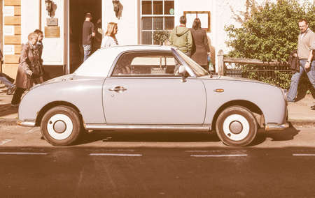 sixties: STRATFORD UPON AVON, UK - SEPTEMBER 26, 2015: Figaro is a small retro car manufactured by Nissan resembling the aesthetics of the sixties cars vintage