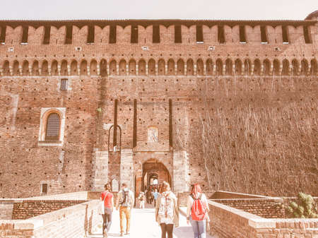 sforza: MILAN, ITALY - APRIL 10, 2014: People visiting the Sforza Castle aka Castello Sforzesco which is the oldest castle in town vintage