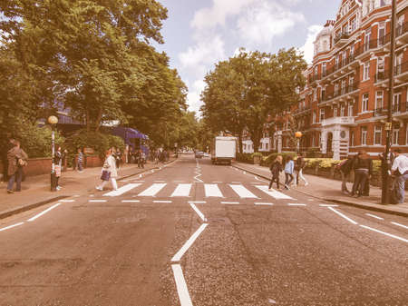 18 year old: LONDON, ENGLAND, UK - JUNE 18: People crossing the Abbey Road zebra crossing made famous by the 1969 Beatles album cover on June 18, 2011 in London, England, UK vintage