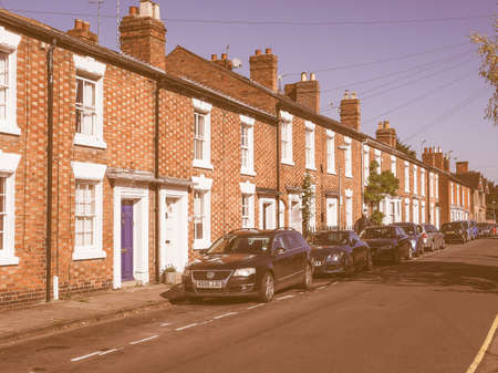 typically british: STRATFORD UPON AVON, UK - SEPTEMBER 26, 2015: A row of typically British terraced houses aka townhouse vintage