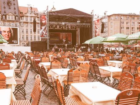 biergarten: LEIPZIG, GERMANY - JUNE 14, 2014: People in beer garden at the Bachfest annual summer music festival celebrating baroque musician Johann Sebastian Bach in his town vintage Editorial