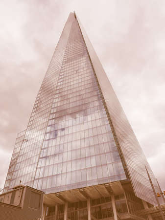 shard: LONDON, UK - JUNE 10, 2015: The Shard skyscraper designed by Italian architect Renzo Piano is the highest building in town vintage