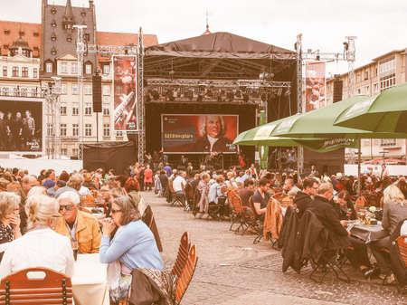 bier festival: LEIPZIG, GERMANY - JUNE 14, 2014: People at the Bachfest annual summer music festival celebrating baroque musician Johann Sebastian Bach in his town vintage