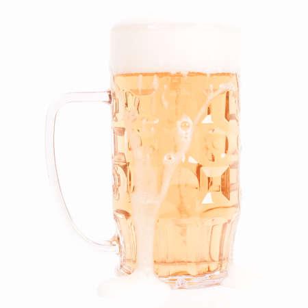 tankard: Large German bierkrug beer mug tankard glass of Lager - isolated over white background vintage Stock Photo