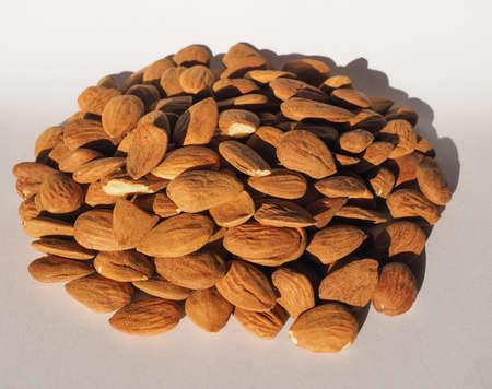 dried fruit: Heap of almonds dried fruit food useful Stock Photo