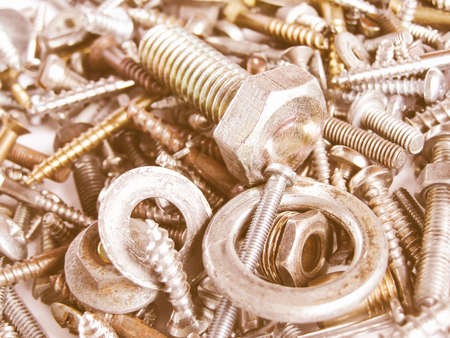 bolts and nuts: Industrial steel hardware bolts, nuts, screws useful as background vintage