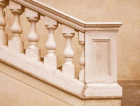 parapet wall: Stone baroque balaustrade as a staircase handrail vintage