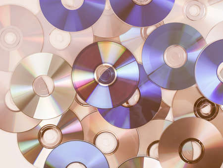 bluray: CD, DVD, BD (Bluray) optical discs for music, video and data storage vintage Stock Photo