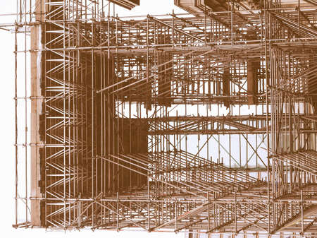 scaffold: Temporary scaffold for construction works at building site vintage