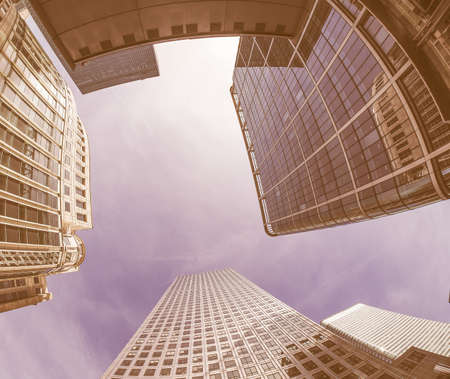 The Canary Wharf business centre in London, UK seen with fisheye vintage