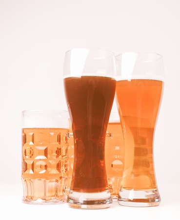 german alcohol: Vintage looking Many glasses of German beers including weiss dunkel and lager Stock Photo