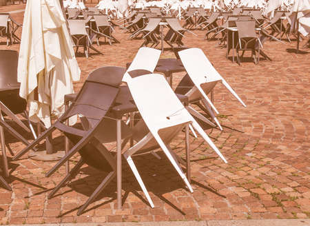 gig: Rows of chairs for outdoor dehors alfresco bar and live gig concert open air events vintage Stock Photo