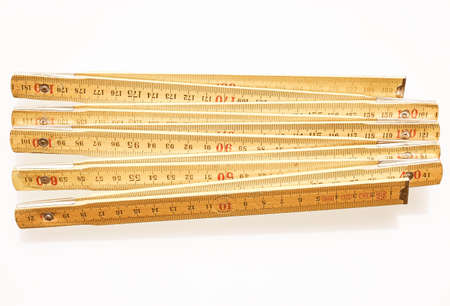 metric: A wooden carpenter ruler with metric units isolated over white vintage