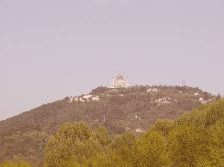 surrounding: View of the hills surrounding the city of Turin, Italy with the Basilica di Superga baroque church on top of the hill vintage