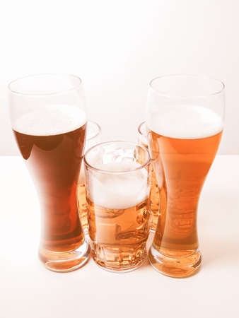 pilsner glass: Many glasses of German beers including weiss dunkel and lager vintage Stock Photo