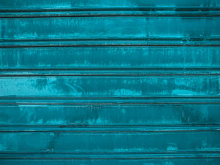 corrugated steel: Grunge green corrugated steel plate useful as a background - cool cold tone
