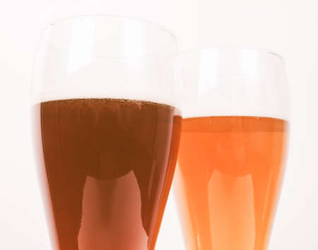 weizen: Vintage looking Two glasses of German dark and white weizen beer Stock Photo