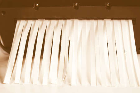 paper shredder: Paper documents cut into strips with a paper shredder vintage