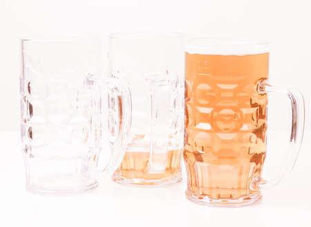 pilsner beer glass: Vintage looking Many large glasses of German lager beer