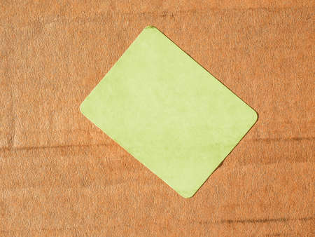 corrugated cardboard: Blank green label on a corrugated cardboard box vintage