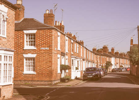 typically british: STRATFORD UPON AVON, UK - SEPTEMBER 26, 2015: A row of typically British terraced houses aka townhouses vintage