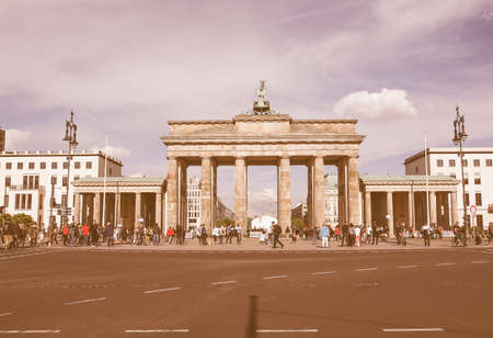 east gate: BERLIN, GERMANY - MAY 09, 2014: Tourists visiting the Brandenburger Tor (Brandenburg Gate) linking East and West Berlin vintage