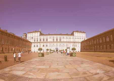 Royal Palace: TURIN, ITALY - CIRCA SEPTEMBER, 2015: Tourists visiting Palazzo Reale meaning Royal Palace seen with fisheye lens vintage