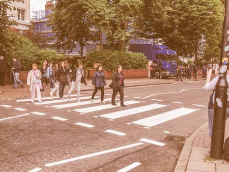 the beatles: LONDON, ENGLAND, UK - JUNE 18: People crossing the Abbey Road zebra crossing made famous by the 1969 Beatles album cover on June 18, 2011 in London, England, UK vintage