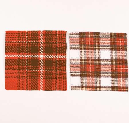 Tartan fabric swatch over white background vintage
