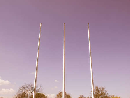 mast: Flagpole flagstaff mast over a blue sky background vintage