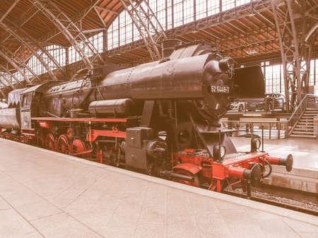 12 class: LEIPZIG, GERMANY - JUNE 12, 2014: Class 52 steam locomotive 52 5448 7 of the Deutsche Reichsbahn at Leipzig Hbf station vintage