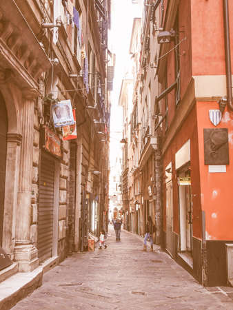well made: GENOA, ITALY - MARCH 16, 2014: Tourists visiting Via del Campo street made famous by Italian musician Fabrizio de Andre in a well known song vintage