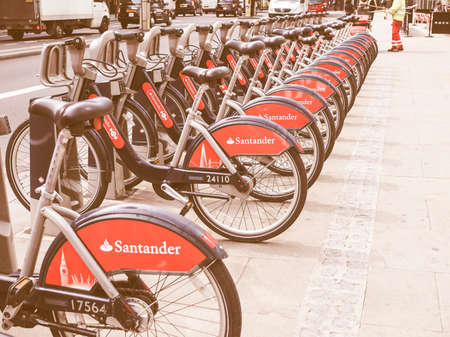sponsor: LONDON, UK - JUNE 12, 2015: Santander is the new sponsor for the public cycle hire vintage Editorial