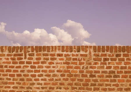 wall clouds: A wall with blue sky with clouds behind vintage Stock Photo
