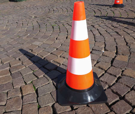 obstruction: Traffic cone to mark road works or temporary obstruction traffic sign