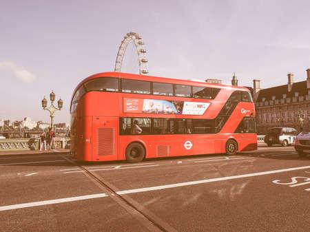 double decker: LONDON, UK - SEPTEMBER 28, 2015: Red double decker bus for public transport in central London vintage